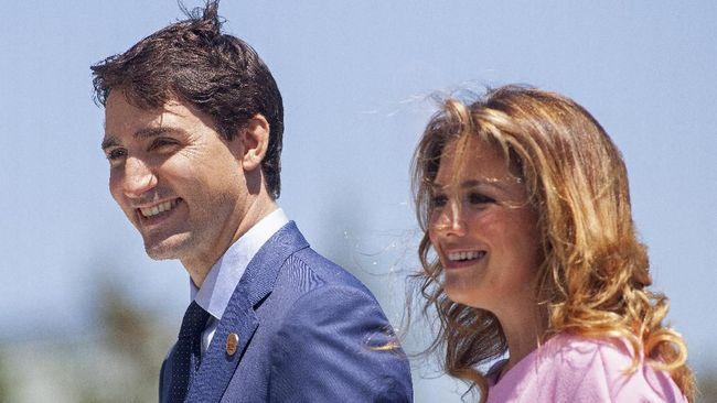 Justin Trudeau dan Sophie Gregoire Trudeau. (AFP/GEOFF ROBINS)